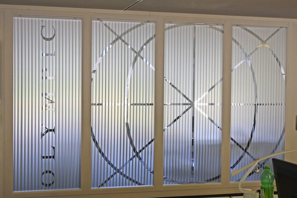 ERI Bancaire SA, Olympic Banking Software, Haupteingang World Trade Center Zürich, Milchglas, Frostfolie, Folienschnitt Folien ausgestanzte Olympic Grafik